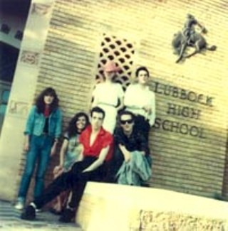 Jones and Strummer (front center) at Buddy Holly High.