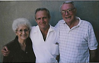 Michael Morton (center) in October 2010, with parents Pat and Bill Morton