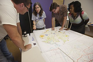 The first public appearance of the city's new comprehensive plan, replete with growth concept maps and priority goals, made its public debut Oct. 1 at an Imagine Austin release party at the Carver Museum & Cultural Center. The event drew about 600 people, including (l-r) Jason Grice, Latinka Sampson, Stephen Bell, and Toya Haley.