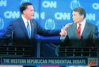 A touch too much: Rick Perry and Mitt Romney square off during the CNN Western Republican Presidential Debate