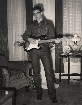 Freeman with his first guitar in his grandmother's living room in Waxahachie.