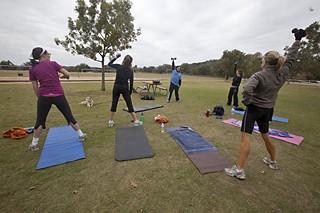 As of Jan. 2, fitness instructors, yoga teachers, and dog trainers who conduct group classes in city parks must obtain a permit, pay a fee, and hold classes in a city-approved park. Zilker Park, where this donation-based class is under way, will still be available for use.