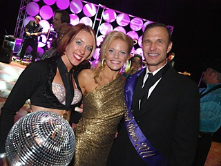 The Dancing With the Stars Austin winner for 2011 is Vaughn Brock (r),  of Brock Investment Group, with his professional dance partner Teletha Jouzdani (l) and dance director/emcee Sabrina Barker-Truscott (c).