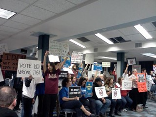 Battle of the banners: AISD's board room splits over the IDEA Public School in-district charter plan for Eastside Memorial