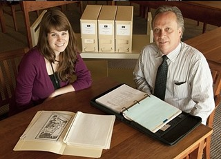 Student volunteer Carly Dearborn and Ransom Center Curator of Film Steve Wilson with materials from the Tom Smith collection (and, yes, that's a storyboard from 'Raiders of the Lost Ark' on the table)