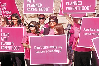 Women rallied at the Capitol last spring in support of Planned Parenthood, which last week sued over the state's attempts to exclude it from the Women's Health Program.