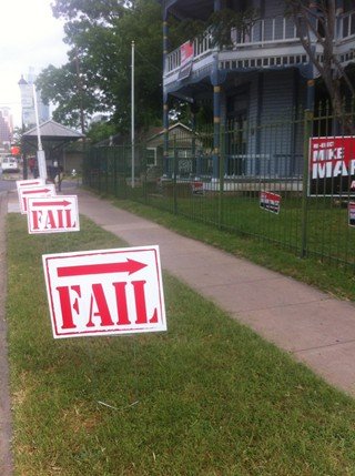 """Fail"" signs posted illegally in front of Mike Martinez's campaign office"