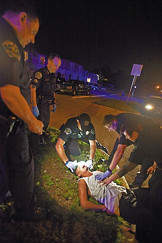 Acevedo and other APD officers subdue a suspect after a fight on May 19.