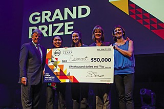 Tommy Meredith (L) with two members of the winning Essmart team, Trisa Thompson, and Suzi Sosa, with the $50,000 Grand Prize for Social Innovation.