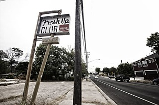 The Fresh Up Club sign at 13th and Chicon is all that remains on the site now slated for new housing.