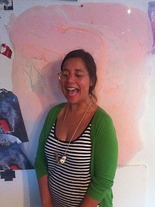 Tickled pink: Laughter erupts in the studio. Here, Solis stands in front of one of her larger Dura-Lar painted elements.