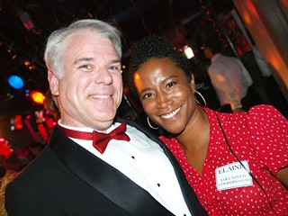 Red Hot emcee Rob Faubion with Project Transitions Volunteer Coordinator Elaine Holton