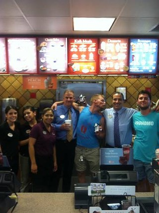 ProHomos JohnMark (center, in Queerbomb shirt) and Jeremy (far right) cavort with Chick-fil-A managers and staff