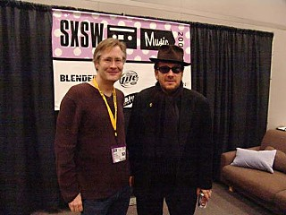 Grulke with Elvis Costello, behind the scenes at SXSW 2005
