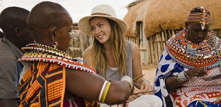 Community members of the Umoja Women's Village in Kenya with actress Olivia Wilde