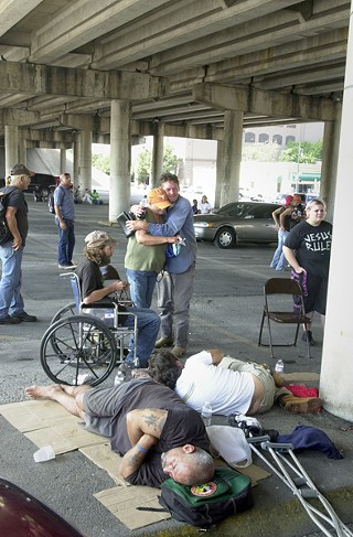 Members of Austin's homeless community hold a Sunday worship service under the I-35 bridge between Sixth and Seventh streets in 2009.