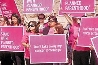 Supporters of Planned Parenthood rally outside the Capitol in 2011