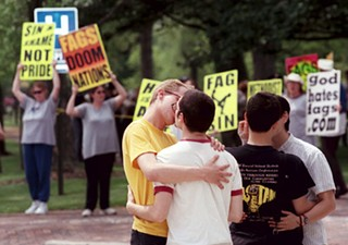 Imagine this, but instead of people kissing, it's race cars: Westboro Baptists coming to F1 in Austin to get really angry about stuff