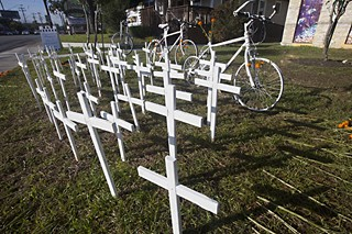 Sixty-seven crosses stand alongside white bicycles outside Bouldin Creek Cafe in tribute to the 67 bicyclists who have died in traffic fatalities this year.