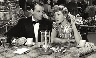 Joel McCrea and Claudette Colbert cuddle up in The Palm Beach Story