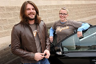 Heyride CEO Josh Huck (l) with driver Rebecca Wood
