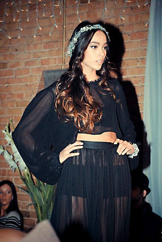 Model Miranda Borrego wears an ensemble from Sofia Mariel's finale collection at the Art Institute's Winter Bazaar.