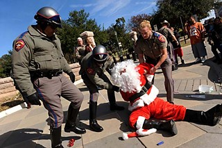 On Friday afternoon, Dec. 21, Texas DPS officers arrested Santa Claus (James Peterson) for criminal mischief and evading arrest after Santa (and others) wrote with chalk on the sidewalk in front of the Capitol, words including peace, community, and love. Occupy Austin maintains this is constitutionally protected free speech; a DPS spokesman said Santa refused a request to stop chalking. See <b><a href=http://austinchronicle.com/newsdesk>Newsdesk</a></b>.