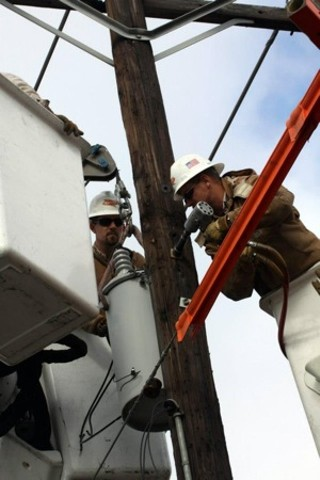 Widespread power outages had AE workers performing a different type of pole dance.