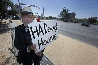Chuck Ragland demonstrates against short-term rentals in front of City Hall in August.
