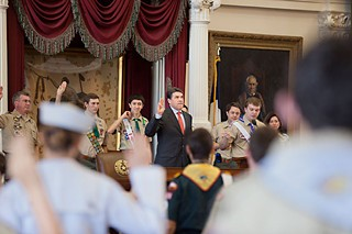 Gov. Rick Perry leads the Scout Oath Feb. 2 at the 64th annual Texas Scouts' Report to the State at the Capitol, where he reaffirmed his stance against allowing gays to join as members or leaders. The national organization is considering allowing local groups to decide whether to drop the existing ban.