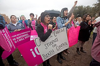 Luz Hernandez (l) and Doresia Gutierrez (r) show their support for family planning at a Planned Parenthood rally last year.