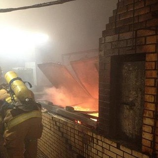 Williamson County Firefighters trying to save the original brick pit at Louie Mueller's