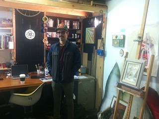 The artist in the midst of his studio, where black meets white