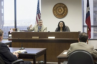 Administrative Law Judges Craig Bennett (l) and Pratibha Shenoy listen to attorneys at a brief hearing March 1, shortly before the City Council's approval of the settlement the same day.
