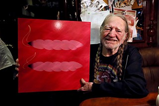 Willie Nelson aboard the <i>Honeysuckle Rose</i> on March 27, with a marriage equality symbol reconceived by <i>Texas Monthly</i> music writer and KGSR deejay Andy Langer and designed locally by Christian Helms of Helms Workshop