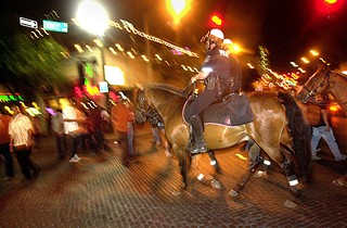 Mounted police patrol on Sixth Street