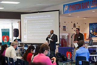 Community members listen to Johns Hopkins' representatives Jeffrey Robinson (l), and Chris Caesar (r) present their plans to get Eastside back on track.