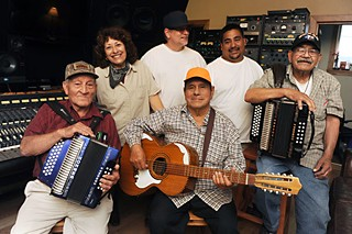 Family portrait: Chencho Flores, Clemencia Zapata, Bradley Jaye Williams, Vicente Alonzo, Javier Cruz, and Isidro Samilpa