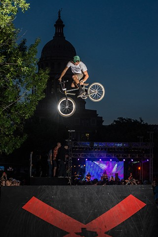 BMX Pro Clint Reynolds roasts a seat grab during the 2014 X games rally June 5 outside the state Capitol. Austin is in the running to host next year's event.