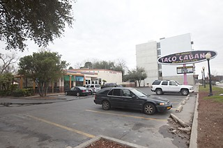 A 96-foot condo may replace this Taco Cabana at Lamar and Riverside.