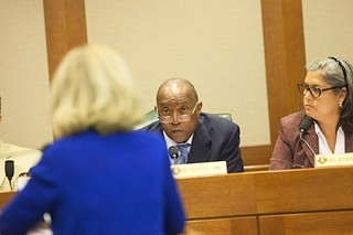 Reps. Sylvester Turner and Jessica Farrar listen to testimony from Rep. Jodie Laubenberg