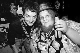 Elijah Wood (l) hangs with Austin's own Harry Knowles (Ain't It Cool News) during SXSW 2006.