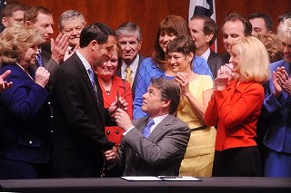 Inside the Capitol Auditorium Gov. Rick Perry today signed HB 2 into law with Sen. Glenn Hegar, the bill sponsor