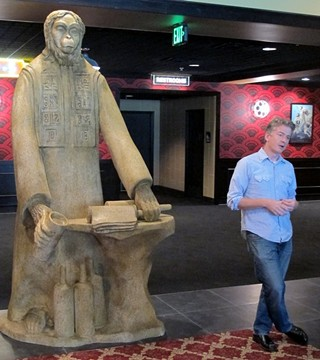 Laying down the law at Lakeline: Alamo Drafthouse CEO Tim League lays out the future of his new Lakeline cinema in front of a custom-cast statue of the Lawgiver from 'Planet of the Apes.'