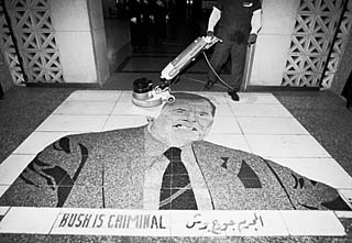 Entrance to Al Rashid Hotel, where diplomats and important media people stay in Baghdad. After the Bush War -- as the Gulf War is known in Iraq -- this mosaic was installed, and guests have to step on George Bush's face as they enter. This photo was taken by Austin photographer Alan Pogue on a trip to Iraq in December.