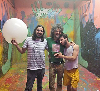 Group hug: (l-r) Zac Traeger, Wayne Coyne, and Shmu