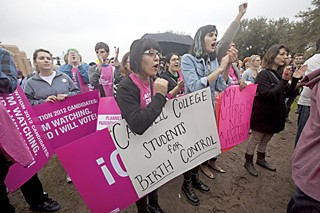 Luz Hernandez (l) and Doresia Gutierrez at a February 2012 Planned Parenthood rally in support of birth control as part of health care coverage provided by Catholic or other religious-affiliated employers opposed to contraceptives