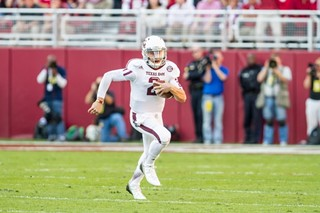 Johnny Manziel scampers for yards Saturday against Ole Miss