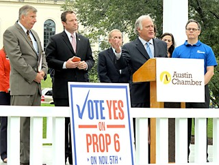 Sen. Kirk Watson, speaking, is joined by GOP Rep. Jason Isaac (c) and 