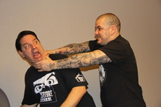 Corey Mitchell (l) settles a booking matter with his Housecore Horror co-founder Phil Anselmo in a professional and mature fashion